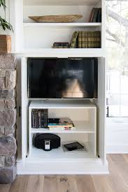 I knew we could make the door open and slide back but I wanted to figure out how to swivel the TV out far enough that you could see if from everywhere
