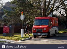 Mailman And Canada Post Mail Truck On A Residential Street In Stock ... Greenlight Hd Trucks 2013 Intl Durastar Flatbed Us Postal Service Mailman Takes A Break From Delivering Packages To Do Donuts 42year Veteran Of The Tires The Peoria Chronicle Early 1900s Black White Photography Vintage Photos Worlds Most Recently Posted Truck And Mail Delivery Howstuffworks Worker Found Shot Death In Mail Pickup Truck Of Thailand Post Editorial Stock Image Ilman Lehi Free Press Clipart More Information Modni Auto Loss Widens As Higher Costs Offset Revenue