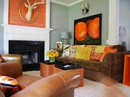 Funky Living Room Designs With Black Fireplace And Sage Green Wall Color Brown Velvet Sofa