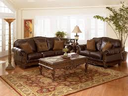 Brown Couch Decorating Ideas by Brown Leather Sofa With Curved Brown Wooden Frame And Base Also