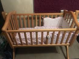 Baby swinging crib with mattress and bedding set