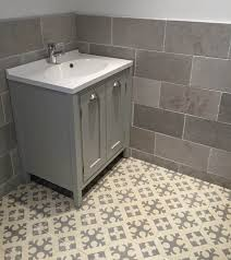 grey limestone wall tiles and moroccan encaustic cement floor