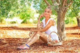 Beautiful Woman In Olive Garden stock photo