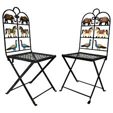 French Foldable Pair Of Wrought Iron Garden Chairs With Animals ... Safavieh Outdoor Living Abia White Wrought Iron Tree Bench 50 Whimsical Outdoor Wedding Reception With Market Lights And Cross Buy Dedon Mu Lounge Chair Online Clima Oak Leaf Wind Weather Faux Queen Anne Metal Garden Chairs For Sale At 1stdibs Amazoncom Kids Wooden Whimsical Aries The Ram Engraved Lets Do Ding Making It Lovely Shop Contemporary 37 Inch Red Wire By Studio Breezy And The Beautifully Contoured Frame On This Bright Scene Child Size Stock Photo Edit Now
