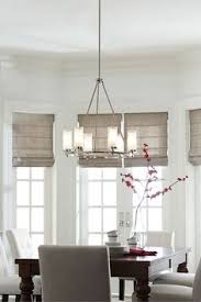 With A Modernized Wagon Wheel Silhouette The Jonah 6 Light Chandelier By Feiss Has Dining Room