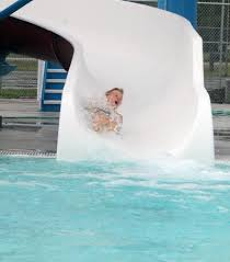 Nathan Burley Comes Down The Lake City Pools New Slide Last Week Won A Drawing To Be First Rider Use GRAPHIC ADVOCATE PHOTO ERIN