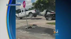 100 Repo Tow Truck Flipboard Florida Man Tries To Flee In Pickup But Its Hooked To
