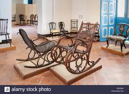 Room With Antique Wooden Rocking Chairs In The Colonial Art Museum ... An Early 20th Century American Colonial Carved Rocking Chair H Antique Hitchcock Style Childs Black Bow Back Windsor Rocking Chair Dated C 1937 Dimeions Overall 355 X Vintage Handmade Solid Maple S Bent Bros Etsy Cuban Favorite Inside A Colonial House Stock Photo Java Swivel With Cushion Natural 19th Century British Recling For Sale At 1stdibs Wood Leather Royal Novica Wooden Chairs Image Of Outdoors Old White On A Porch With Columns Rocker 27 Kids