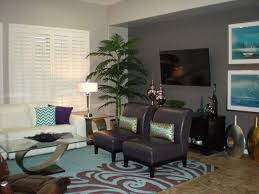 Tall Accents Of Green Balance The Use Violet And Sea Blue Throughout Room
