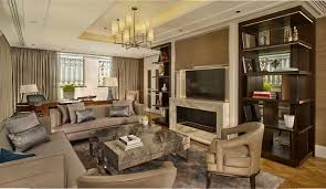 Living Room With Fireplace In The Middle by Luxury Hotel Suite Accommodation Budapest The Ritz Carlton Budapest