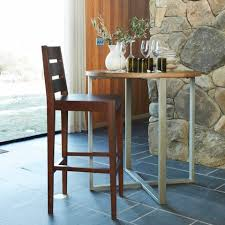 Courtesy West Elm Round Tables Like Elms Rustic Counter Table Create An Illusion Of