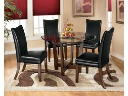 Charrell 5 Piece Round Dining Table Set With Black Chairs By Ashley  Signature Design At Rooms And Rest Madison County Ding Table Set With Extension Tamilo Ding Room Chair Ashley Fniture Homestore Pin On Ding Tables And Chairs Most Regard Set Cushions Chairs Comfortable Wat Indoor Covers Black Modern Mhattan Comfort York 5piece Solid Wood With 1 Table 4 540 Area Tile Wooden Patings Decorative Giantex 5 Piece Upholstered Mid Century Apartment Linen Fabric Cushioned Seats Large Amazing Brie Hooker Hill Country