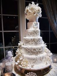 White Wedding Cake With An Ornate Crystal Design