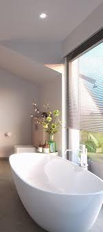 eine elegante badewanne vor großem fenster wellness pur