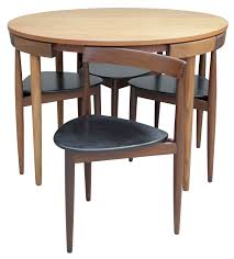 Hans Olsen Dining Table With Four Chairs For Frem Rojle, Denmark 1960's Ding Room Fniture Cluding A Table Four Chairs By Article With Tag Oval Ding Tables For 8 Soluswatches Ercol Table And Chairs Elm 6 Kitchen Room Interior Design Vector Stock Rosewood Set Extendable Whats It Worth Find The Value Of Your Inherited Fniture Wikipedia Danish Teak Wood Chairs Circa 1960 Set How To Identify Genuine Saarinen Table Scandart Vintage Mid Century S Golden Elm Extending 4