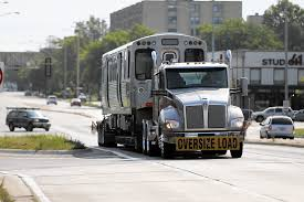 CTA Rail Cars Hit The Road Due To Yellow Line Track Outage - Chicago ...