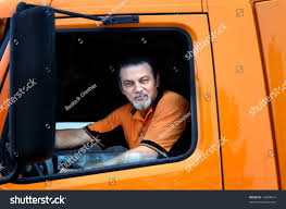 Truck Driver Sits Cab His Orange Stock Photo (Edit Now) 18293614 ... Woman Truck Driver Looking Out The Door Of A Big Rig From Stock Driver Shortage In Industry Baku Experience Life Trucker Truck On Xbox One Looking In Sideview Mirror Photo Getty Images Military Veteran Driving Jobs Cypress Lines Inc Owner Operator Application Are You For Traing Brisbane We Are Good Garbage Waste Management Trains Senior Throw The Window Picture Male Out Of Image Forwarding Sits Cab His Orange Edit Now 18293614 Guy Pickup At Shotgun Video Footage Videoblocks
