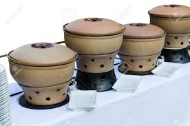 Thai Clay Pottery Chafing Dish Heaters At The Banquet Table With