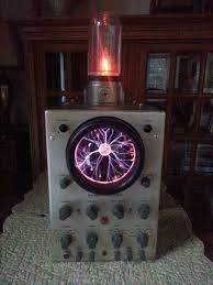 plasma installed inside a vintage osiliscope on top a