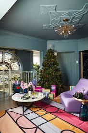 weihnachtsbaum im bunten wohnzimmer mit bild kaufen