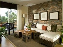 Living Room With Elements Of The Outdoors Wicker Sofa Wooden Crate Table Brick