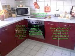 bordeauxrote hochglanz küche mit e geräten in leverkusen