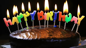 lighted candles on a happy birthday cake candles with the words happy birthday on a chocolate cake hand lights a candle happy birthday Stock Video Footage