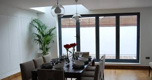 A 4 Door Bi Fold In Grey Gives This Dining Area Light And Airy Appearance