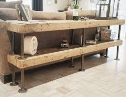 DIY Shelving Made Of Rustic Wood Boards And Pipes Is A Simple Solution To Add Some