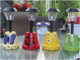 Paint Terracotta Pots With Different Designs Drill Holes In The Base And Put Solar Lamp Posts