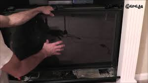 How To Put In A Gas Fireplace by How To Remove U0026 Clean The Glass On A Gas Fireplace Youtube