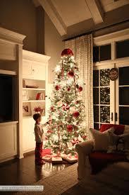 Living Room Apartment Christmas Decorating Light Gray Wallpaint Small Circular 3 Leg Table Red And