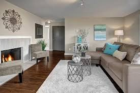 contemporary living room with hardwood floors by stacey lange