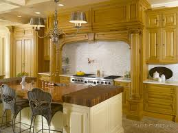 Kitchen Soffit Decorating Ideas by Island With Butcher Blocks On Ends And Sink In Middle Of Island