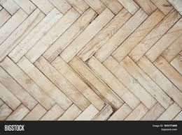 Top View On Rich Texture Of Old Brushed And Distressed Wooden Parquet Floor Made From Many