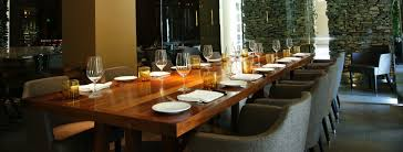 Long Wooden Table Set With Dinnerware For Private Dining