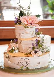 This Rustic Birch Log Cake With Wildflowers And Violets Is One Of The Prettiest Wedding Cakes