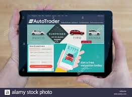 A Man Looks At The Auto Trader Website On His IPad Tablet Device ... Used Citroen C4 Cars For Sale On Auto Trader Uk Autotrader For Android Apps Google Play Kia Rio 2011 Ford F150 Truck New Car Review Autotrader Youtube A Man Looks At The Website His Ipad Tablet Device Chevrolet Classics Autotraderca Automotive Dealer Wordpress Theme Camper Rvs Rvtradercom 2009 Dodge Ram 1500 4x4 Crew Cab Uk Trucks Tautotrader 28 Autoup10999 Honda Bm Sales Dealership In Surrey Bc V4n 1b2