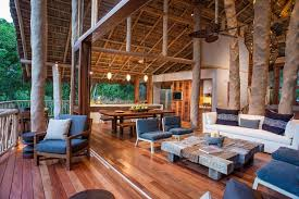 Tree Trunk Columns Living Room Tropical With Rustic Wood Table Plants And Trees