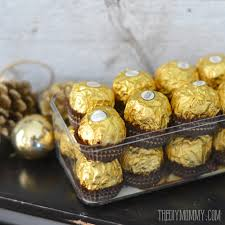 Ferrero Rocher Christmas Tree Stand by A Gold And Black Christmas And New Year U0027s Dessert Table Idea With