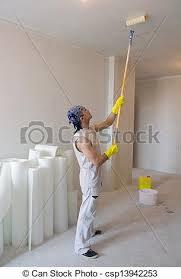 images de stock de ouvrier plafond peinture rouleau plafond