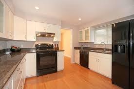 White Kitchen Cabinets With Black Appliances Home Design Ideas