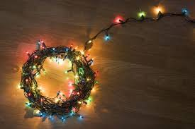 Coil Of Light Christmas Lights Lying On Floor Elevated View