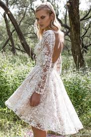 A Nude Lace High Low Wedding Gown With Long Sleeves Bateau Neckline