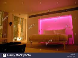 bedroom with colour mood lighting in st martins hotel st martins