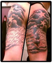 Black Ink Clouds With Stars And Quote Tattoo On Right Half Sleeve