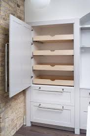 hidden pantry with stacked pull out shelves transitional