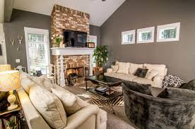 Living Room Brick Fireplace with wood wrapped mantle Craftsman