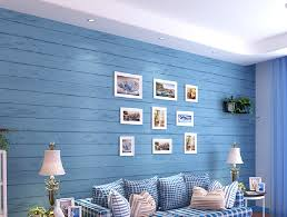 light blue wallpaper living room decorated in a mediterranean
