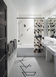 modern home with bath room ceramic tile floor pedestal sink